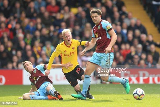 Will Hughes of Watford and James Tarkowski of Burnley chase down the ball during the Premier League match between Watford and Burnley at Vicarage...