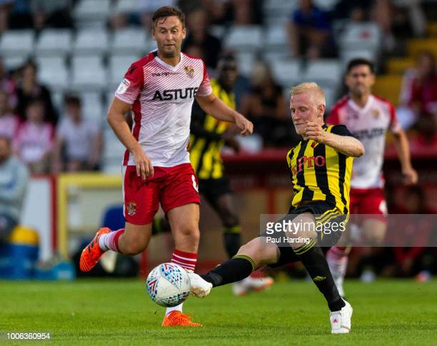 Will Hughes of Watford and Joel Byram of Stevenage fight for the ball during the preseason friendly match between Stevenage and Watford at The Lamex...