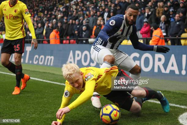 Will Hughes of Watford and Matt Phillips of West Bromwich Albion during in the Premier League match between Watford and West Bromwich Albion at...