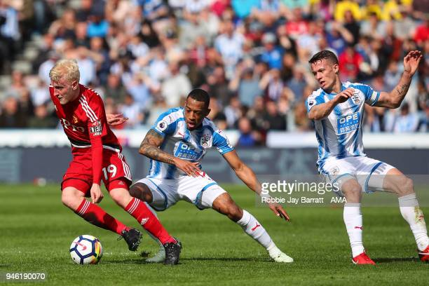 Will Hughes of Watford and Rajiv Van La Parra of Huddersfield Town during the Premier League match between Huddersfield Town and Watford at John...