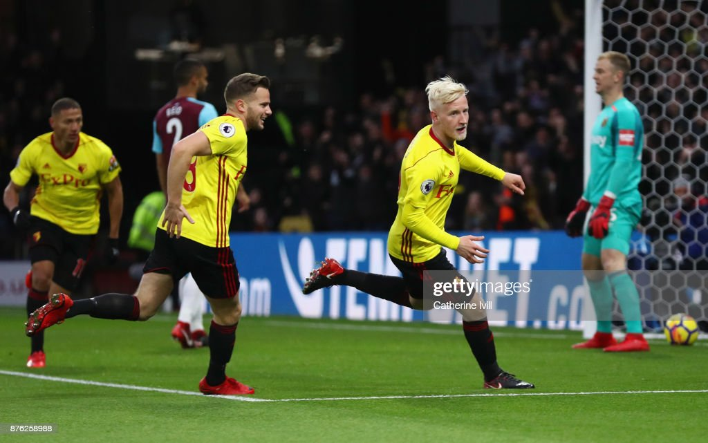 Will Hughes of Watford celebrates as he scores their first goal with team mates during the Premier League match between Watford and West Ham United at Vicarage Road on November 19, 2017 in Watford, England.