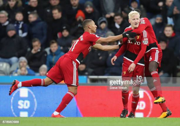 Will Hughes of Watford celebrates scoring his sides first goal with his Watford team mates during the Premier League match between Newcastle United...
