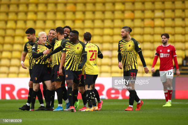 Will Hughes of Watford celebrates with teammates after scoring his team's third goalduring the Sky Bet Championship match between Watford and Bristol...