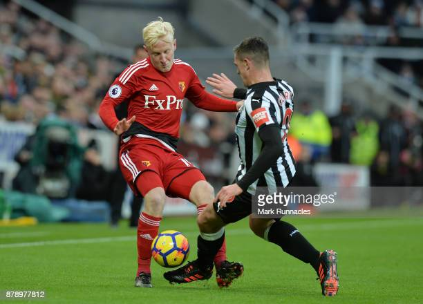 Will Hughes of Watford competes for the ball with Ciaran Clark of Newcastle United during the Premier League match between Newcastle United and...