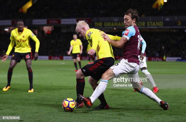 Will Hughes of Watford holds off Mark Noble of West Ham United during the Premier League match between Watford and West Ham United at Vicarage Road...