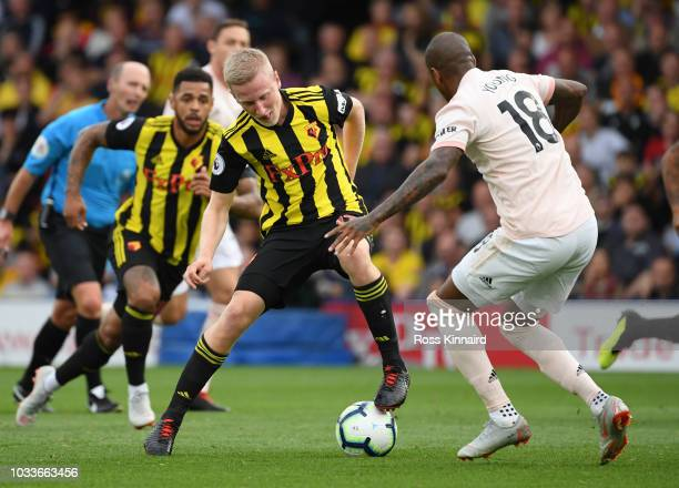 Will Hughes of Watford is challenged by Ashley Young of Manchester United during the Premier League match between Watford FC and Manchester United at...