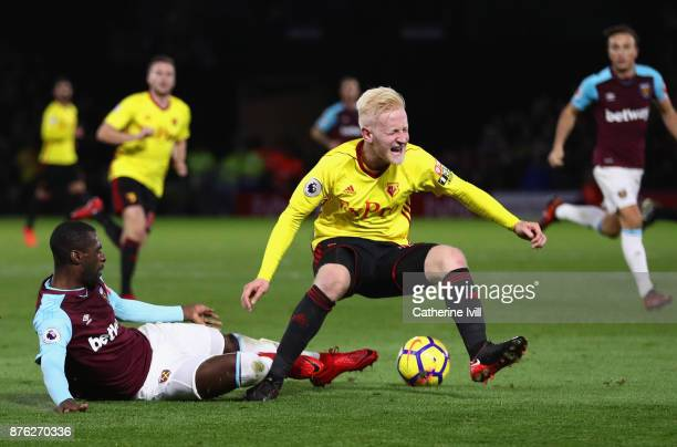 Will Hughes of Watford is tackled by Pedro Obiang of West Ham United during the Premier League match between Watford and West Ham United at Vicarage...