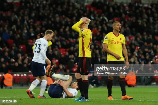 Will Hughes of Watford reacts to Richarlison of Watford sending a good chance over the bar during the Premier League match between Tottenham Hotspur...