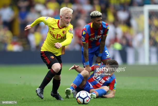 Will Hughes of Watford runs with the ball away from Yohan Cabaye of Crystal Palace and Patrick van Aanholt of Crystal Palace during the Premier...
