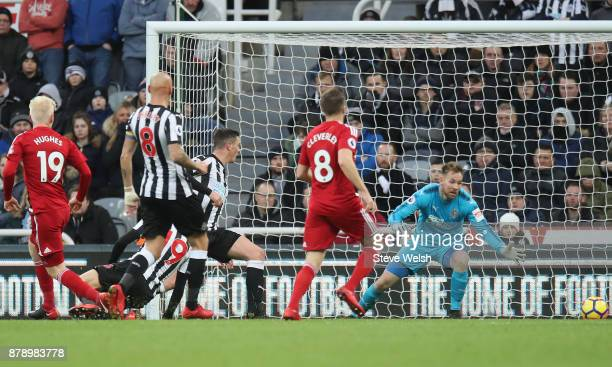 Will Hughes of Watford scores his sides first goal during the Premier League match between Newcastle United and Watford at St James Park on November...