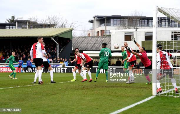 Will Hughes of Watford scores his team's first goal during the FA Cup Third Round match between Woking and Watford at Kingfield Stadium on January 6...
