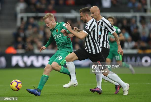 Will Hughes of Watford vies with Paul Dummett of Newcastle United during the Premier League match between Newcastle United and Watford FC at St James...