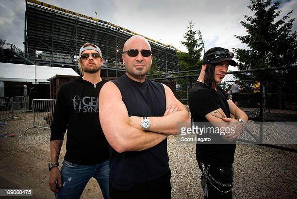 Will Hunt David Draiman and Geno Lenardo of Device pose backstage during 2013 Rock On The Range at Columbus Crew Stadium on May 19 2013 in Columbus...