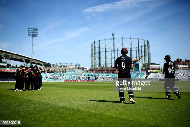 Will Jacks and Dean Elgar of Surrey make their way out to open the batting during the Royal London OneDay Cup match between Surrey and Somerset at...