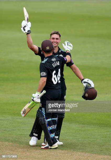 Will Jacks of Surrey celebrates his century with Dean Elgar of Surrey during the Royal London OneDay Cup match between Surrey and Gloucestershire at...