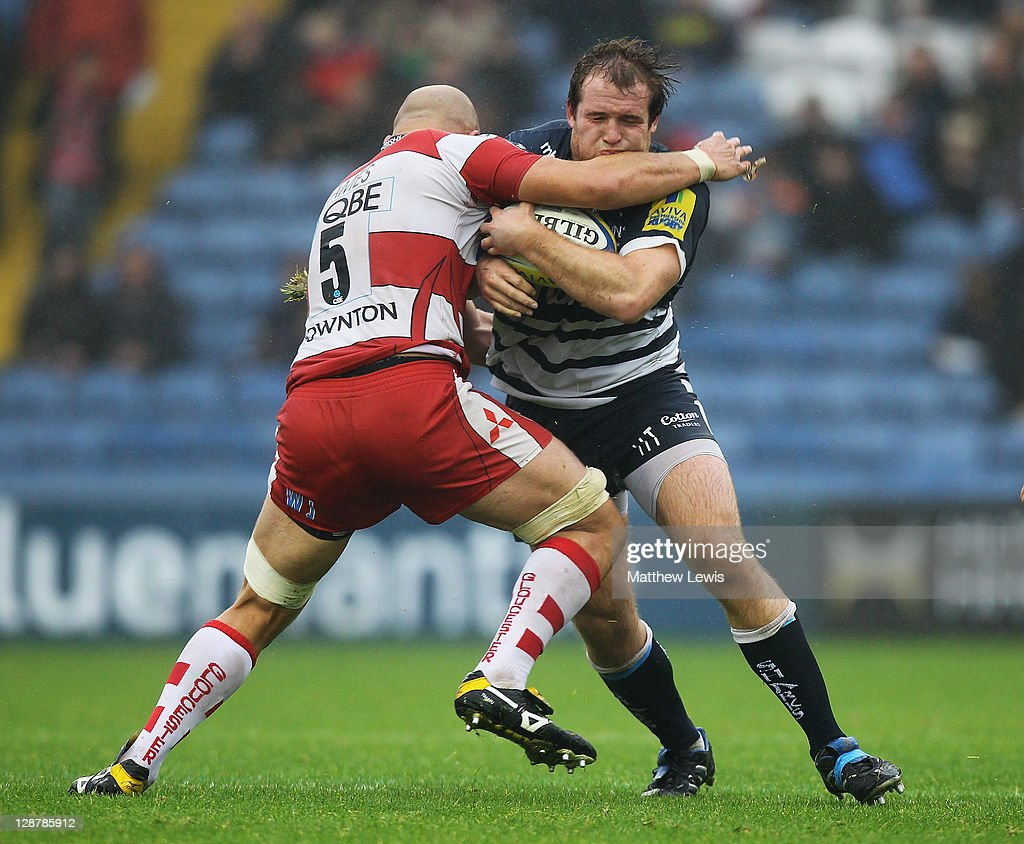 Will James of Gloucester tackles Henry Thomas of Sale during the AVIVA Premiership match between Sale Sharks and Gloucester at Edgeley Park on October 8, 2011 in Stockport, England.