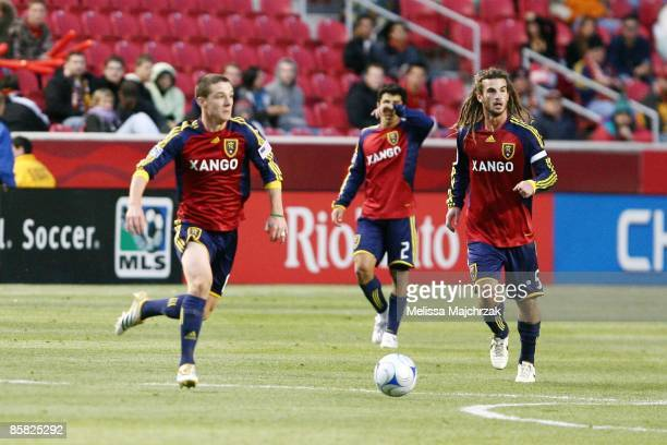 Will Johnson and Kyle Beckerman of Real Salt Lake kick the ball during the game against the Columbus Crew at Rio Tinto Stadium on April 2 2009 in...