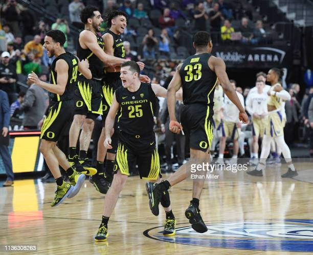Will Johnson Ehab Amin Miles Norris Luke Osborn and Francis Okoro of the Oregon Ducks celebrate as time expires in their 6848 victory over the...