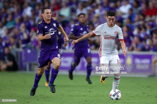 Will Johnson of Orlando City and Miguel Almiron of Atlanta United during the MLS match between Atlanta United and Orlando City at Orlando City...