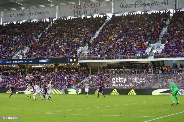 Will Johnson of Orlando City SC attempts a shot on goal past Carlos Carmona of Atlanta United during a MLS soccer match between Atlanta United FC and...