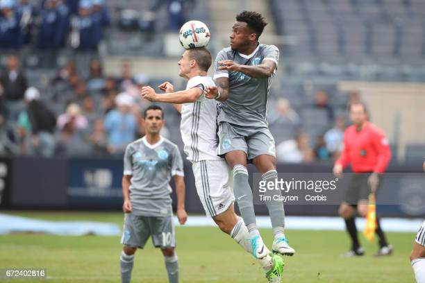 Will Johnson of Orlando City SC is challenged by Rodney Wallace of New York City FC in action during the New York City FC Vs Orlando City SC regular...