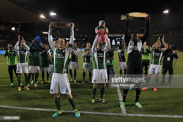 Will Johnson of the Portland Timbers hoists his timber slab for scoring the game winning goal Jack Jewsbury of Portland Timbers lifts Johnson's...