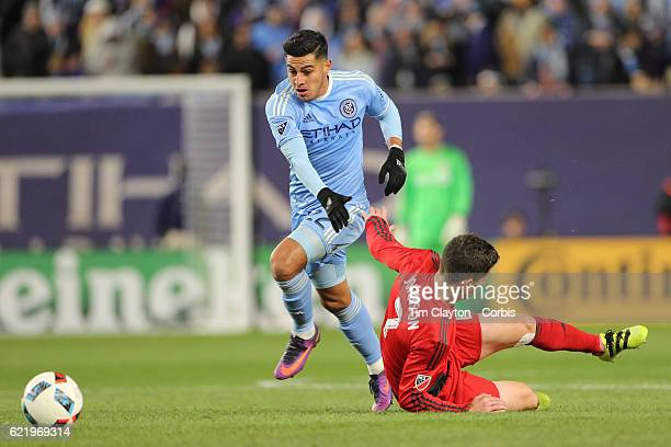 Will Johnson of Toronto FC is fouled by Ronald Matarrita of New York City FC during the NYCFC Vs Toronto FC MLS playoff game at Yankee Stadium on...