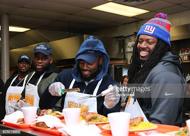 Will Johnson Owa Odighdizuwa Landon Collins and Adam Gettis appear to serve at Food Bank for New York City's Community Kitchen of West Harlem on...
