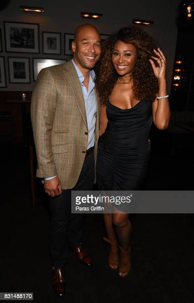"""Will Jones and Cynthia Bailey at Survivor's Remorse x Upscale Magazine """"Champions Table"""" Private Dinner at American Cut on August 14, 2017 in..."""