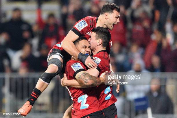 Will Jordan of the Crusaders is congratulated by team mates after scoring a try during the round 5 Super Rugby Aotearoa match between the Crusaders...