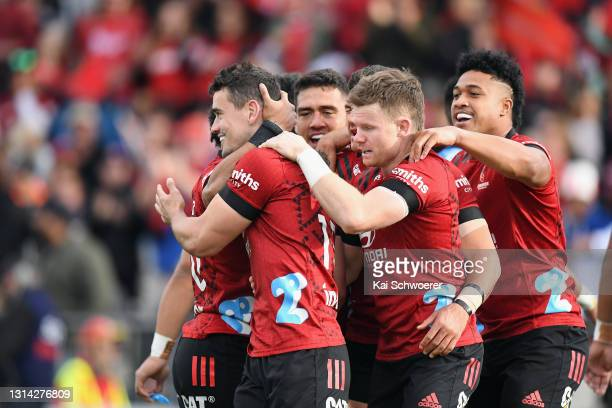 Will Jordan of the Crusaders is congratulated by team mates after scoring a try during the round nine Super Rugby Aotearoa match between the...