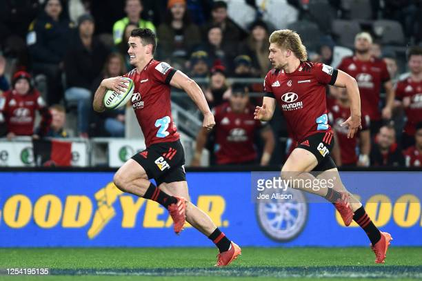 Will Jordan of the Crusaders on his way to score a try during the round 4 Super Rugby Aotearoa match between the Highlanders and the Crusaders at...