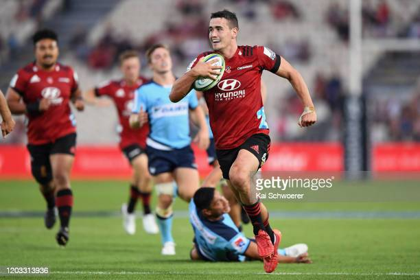 Will Jordan of the Crusaders runs through to score a try during the Round 1 Super Rugby match between the Crusaders and the Waratahs at Trafalgar...