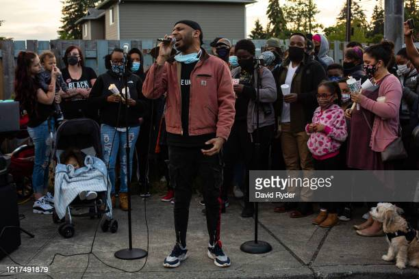 Will Jordan sings during a vigil for Manuel Ellis a black man whose March death while in Tacoma Police custody was recently found to be a homicide...