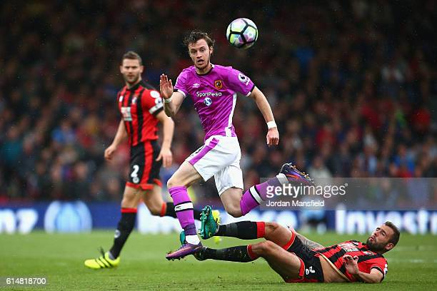 Will Kean of Hull City is tackled by Steve Cook of AFC Bournemouth during the Premier League match between AFC Bournemouth and Hull City at Vitality...