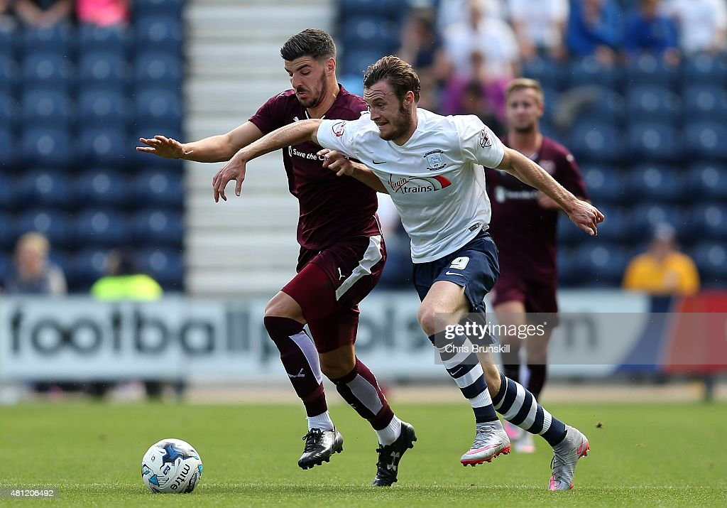 Will Keane of Preston North End in action with Callum Paterson of Hearts during the pre season friendly match between Preston North End and Hearts at Deepdale on July 18, 2015 in Preston, England.