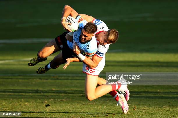 Will Kennedy of the Sharks is tackled by Zac Lomax of the Dragons during the round five NRL match between the St George Illawarra Dragons and the...