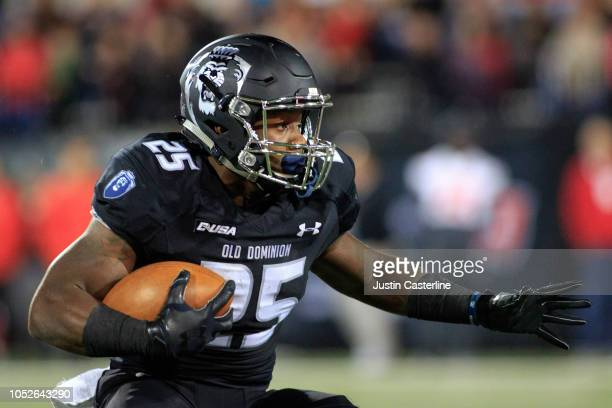 Will Knight of the Old Dominion Monarchs runs the ball in the game against the Western Kentucky Hilltoppers on October 20 2018 in Bowling Green...