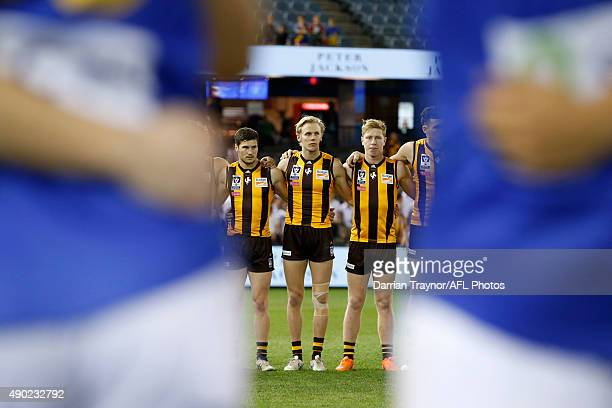 Will Langford of Box Hill lines up with team mates for the national anthem before the VFL Grand Final match between Williamstown and Box Hill at...