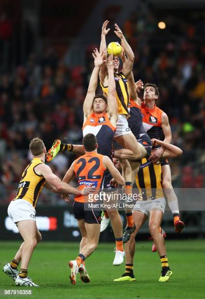 Will Langford of the Hawks is challenged by Jonathon Patton of the Giants during the round 15 AFL match between the Greater Western Sydney Giants and...