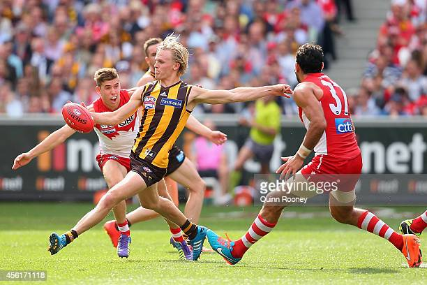 Will Langford of the hawks kicks during the 2014 AFL Grand Final match between the Sydney Swans and the Hawthorn Hawks at Melbourne Cricket Ground on...