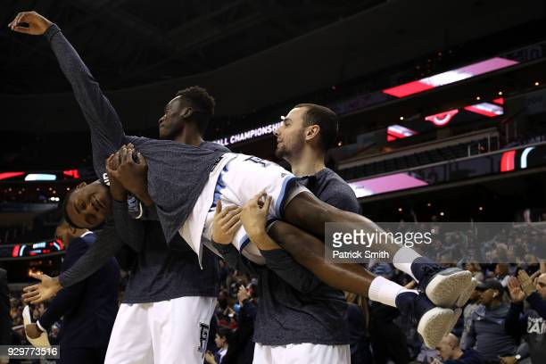 Will Leviton of the Rhode Island Rams is held up by teammates Michael Tertsea and Eric Dadika after a point against the Virginia Commonwealth Rams...