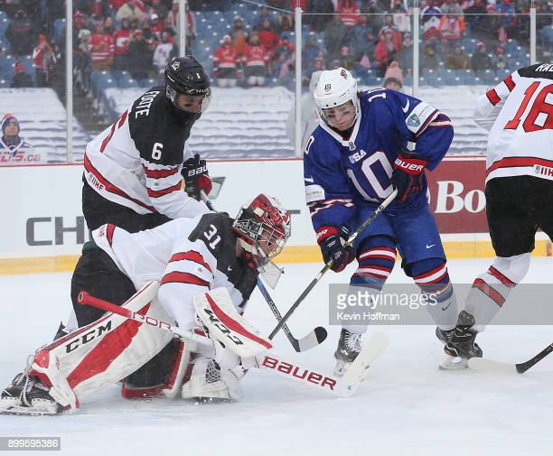 Will Lockwood of United States is stopped by Carter Hart of Canada in the first period during the IIHF World Junior Championship at New Era Field on...
