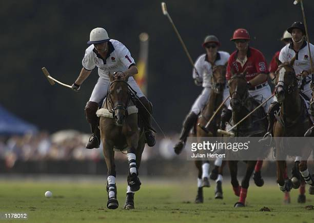 Will Lucas of England leads the charge to the ball during the match against The Rest Of The Commonwealth for The Coronation Cup during Cartier...
