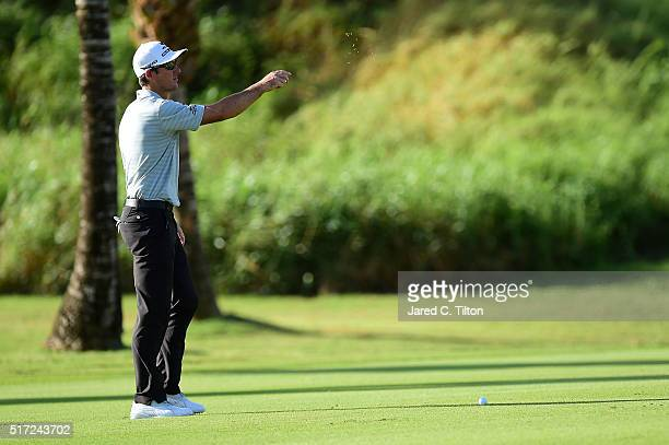 Will MacKenzie checks the wind direction prior to playing his second shot on the 12th hole during the first round of the Puerto Rico Open at Coco...