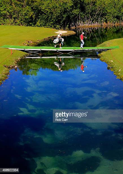 Will Mackenzie of the United States walks across a bridge to the 14th green during the first round of the OHL Classic at Mayakoba on November 13 2014...