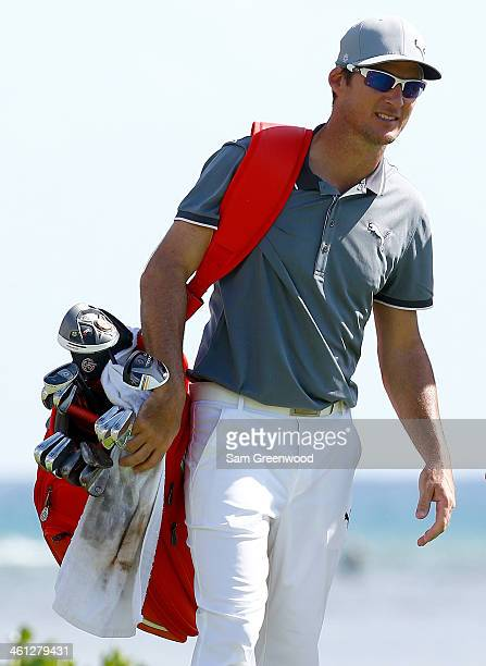 Will MacKenzie stands with his golf bag during a practice round prior to the Sony Open in Hawaii at Waialae Country Club on January 7 2014 in...