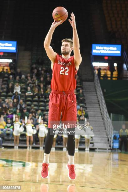 Will Magarity of the Davidson Wildcats takes a jump shot during a college basketball game against the George Mason Patriots at the Eagle Bank Arena...