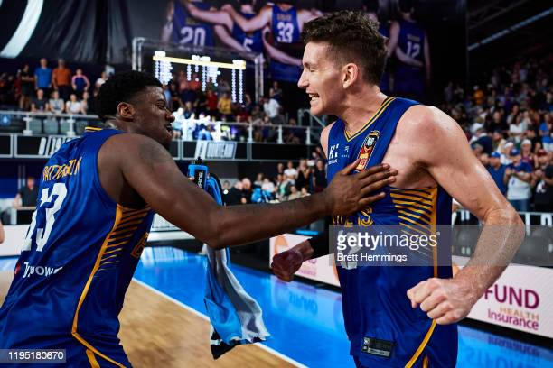 Will Magnay of the Bullets and Lamar Patterson of the Bullets celebrate victory during the round 12 NBL match between the Brisbane Bullets and the...