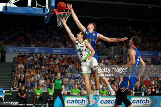 Will Magnay of the Bullets blocks Ben Madgen of the Phoenix during the round 17 NBL match between the Brisbane Bullets and the South East Melbourne...